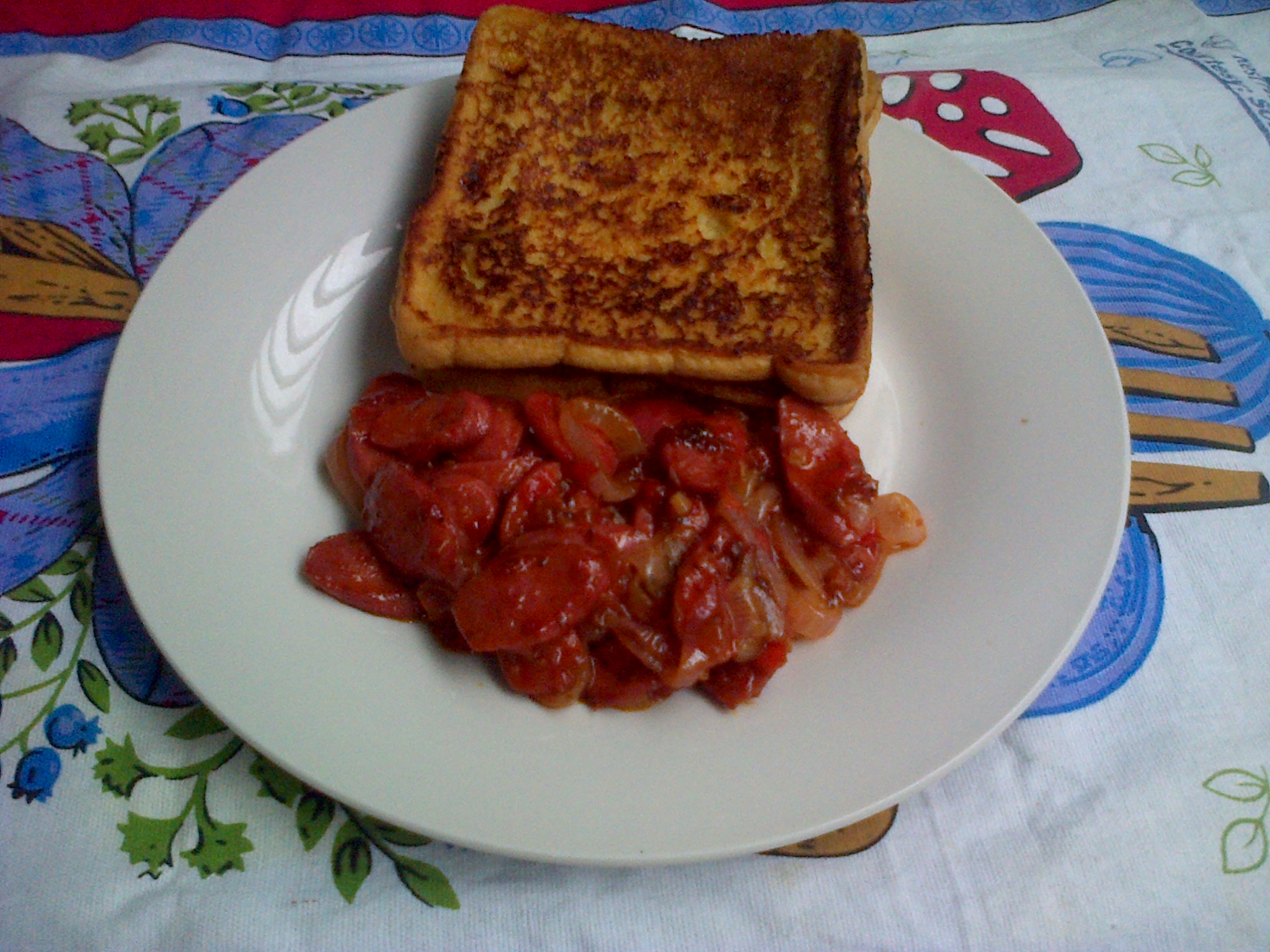 Golden French toast and sautéed sausages