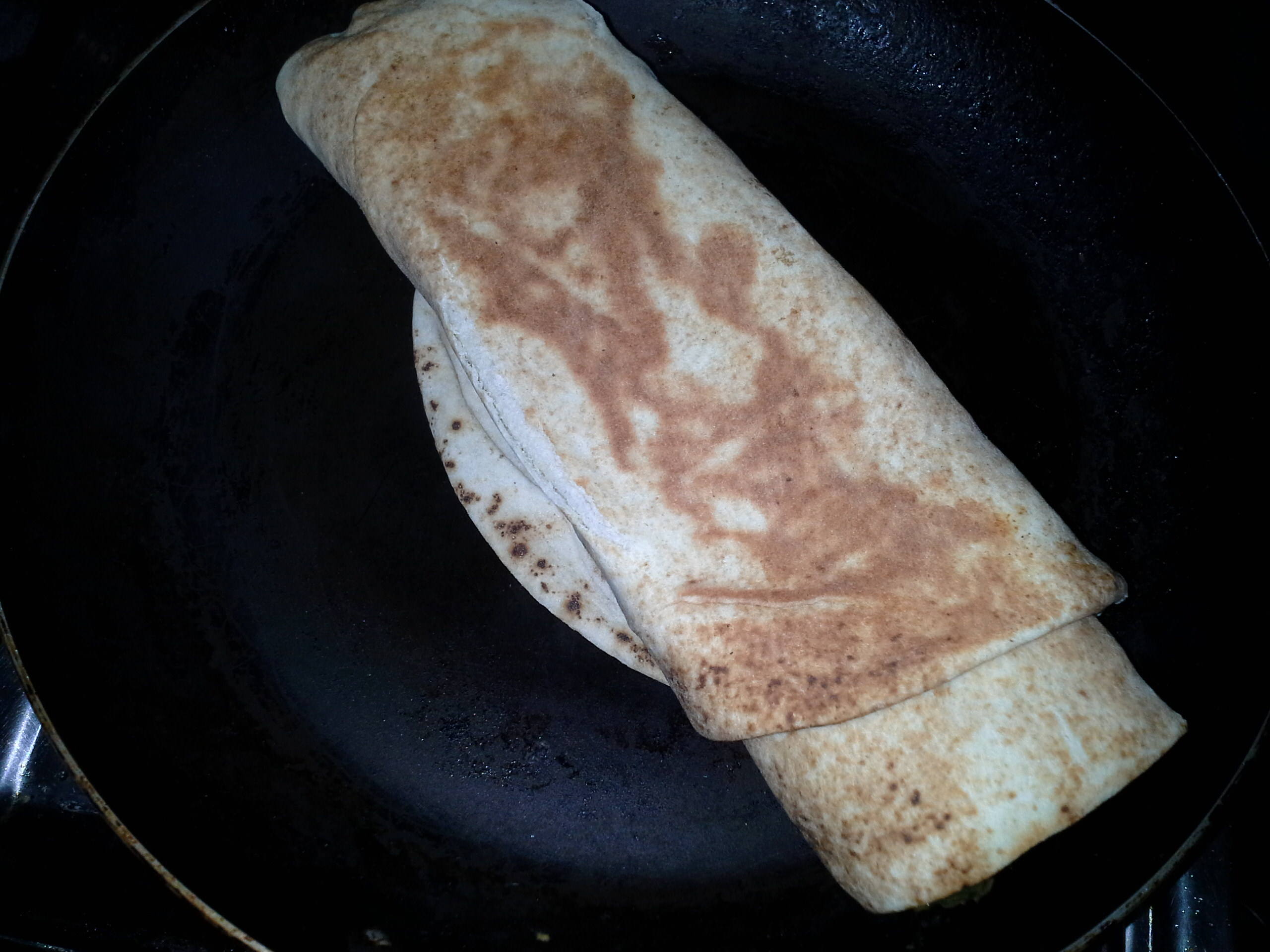 Roll it up and fry in a non-stick pan over low heat till both sides are golden brown