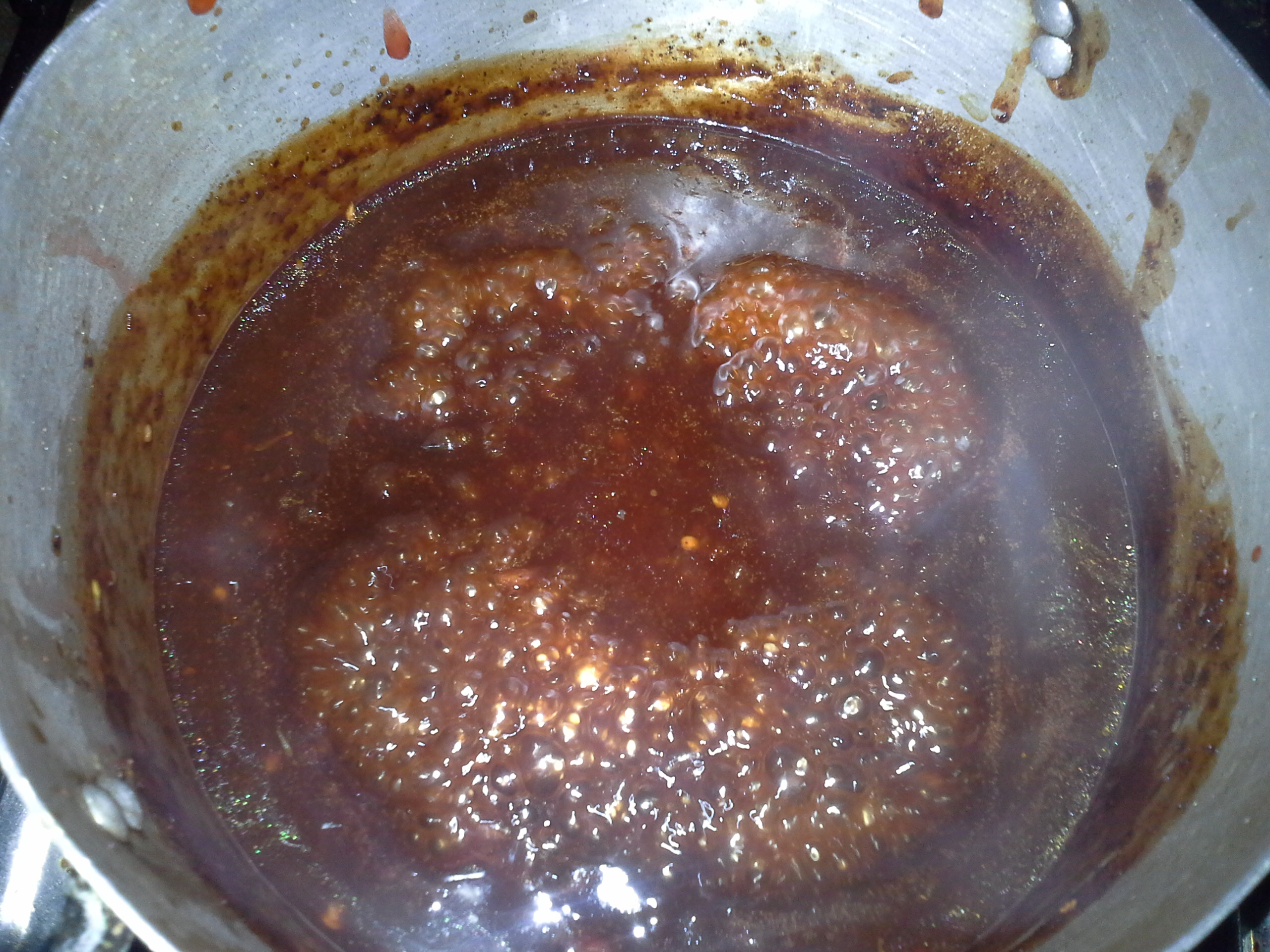 Let the marinade boil vigorously for 5 minutes, then add 5 tablespoons of ketchup and extra dry Cameroon pepper if you wish