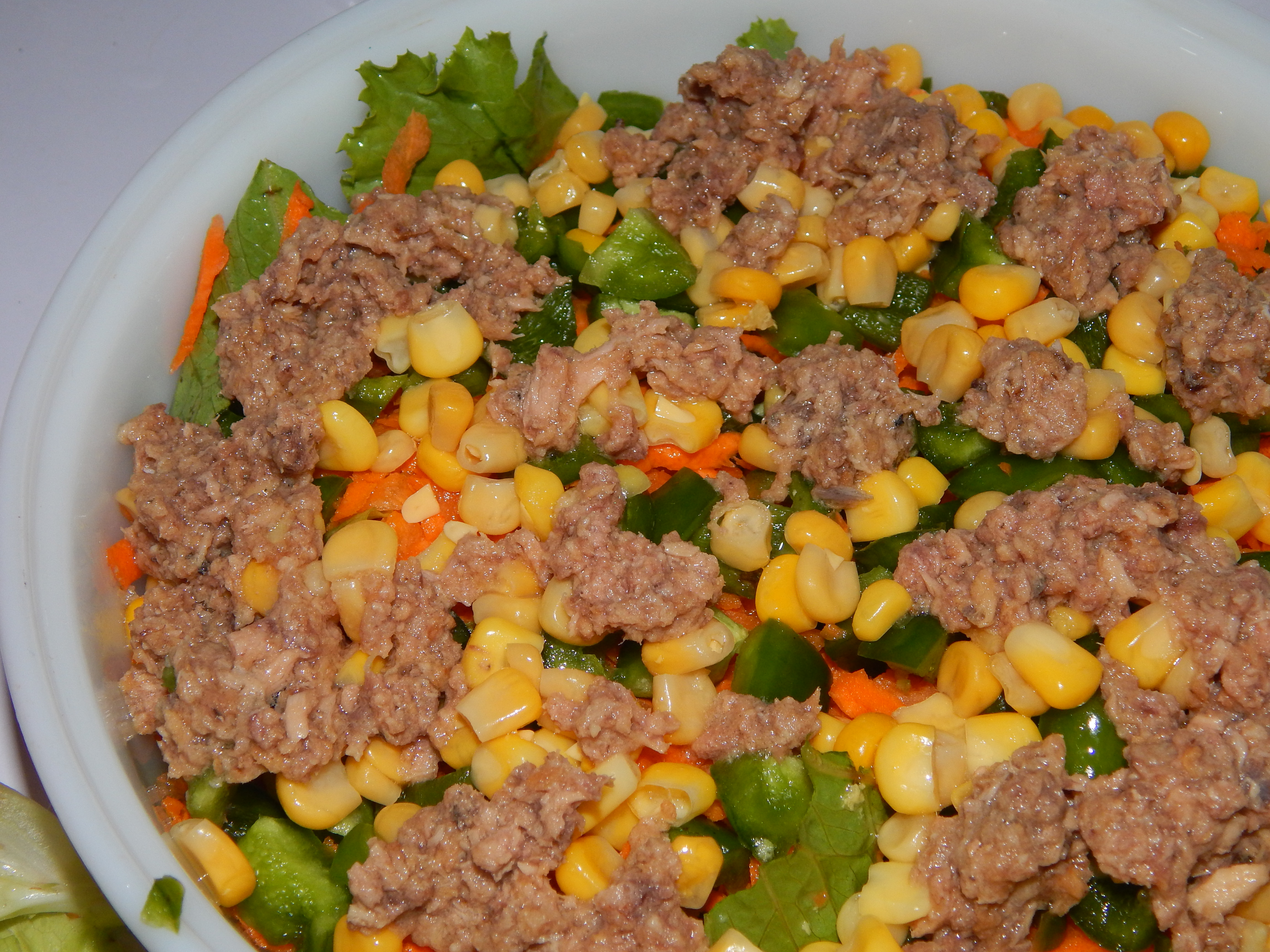 Generously load on the tuna and sweet corn