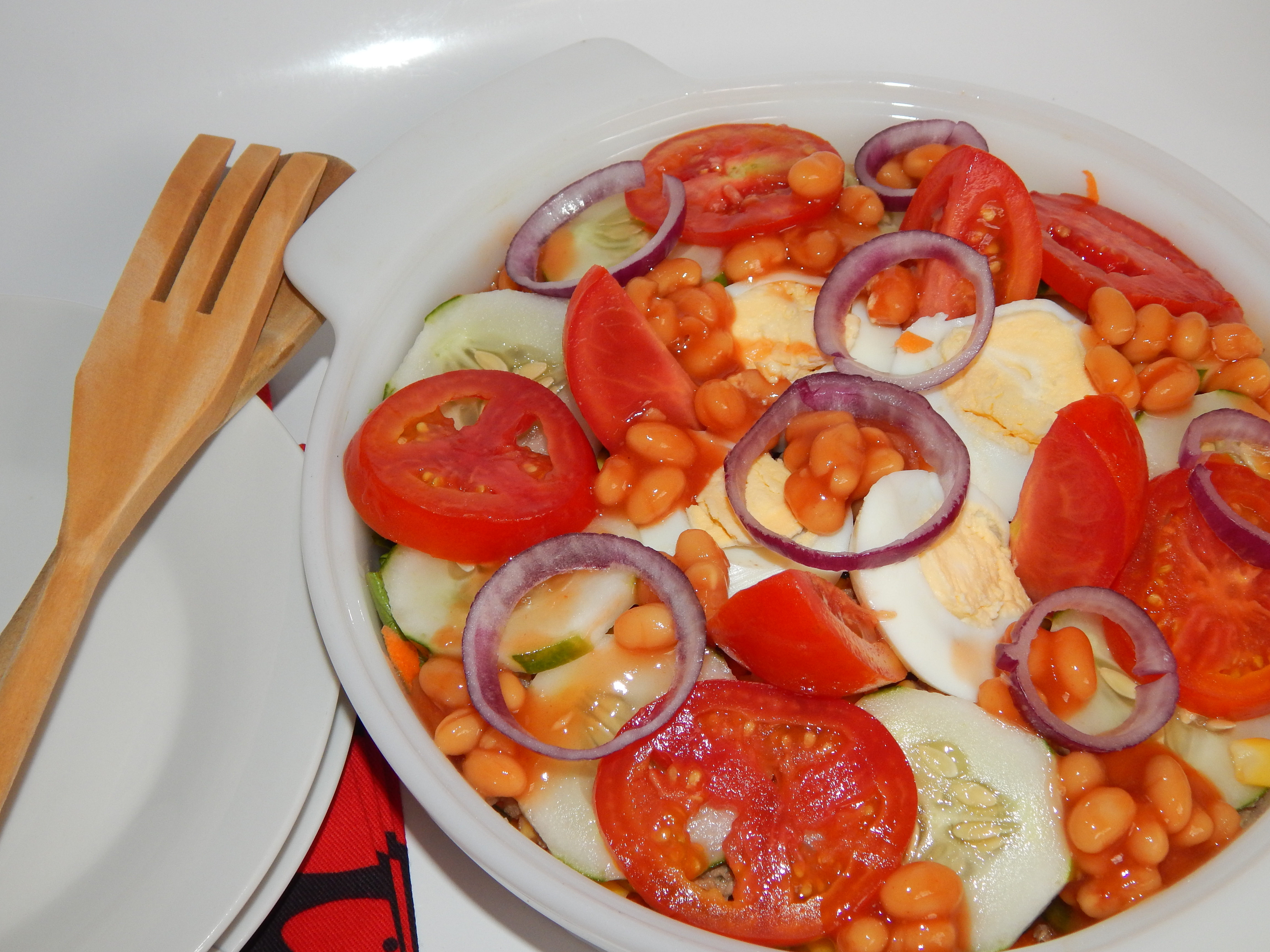 Finish off with cucumbers,  baked beans,  eggs, tomatoes and onions if using